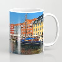 "copenhagen Mugs featuring New Port ""Copenhagen"" by Alan Pary"