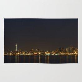 The Seattle, Washington skyline at night Rug