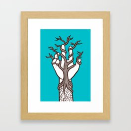 Bare tree growing within a hand – interlacing of nature and humanity Framed Art Print