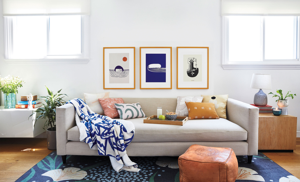 living room with blue and neutral decor