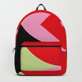 Snake Shaped Window in a black wall. Red and pink acorns in the background, on a soft green grass. Backpack