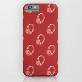 Red over ear headphones on red background pattern iPhone Case