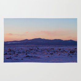Mountain Sunset in the winter Rug