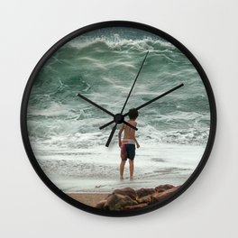 small boy against the sea Wall Clock