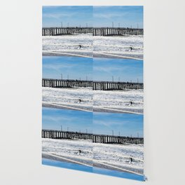 A Panoramic View Of Pismo Beach Pier, Surfers And Ocean Wallpaper