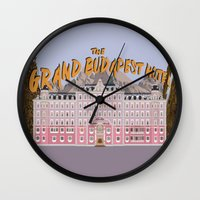 budapest hotel Wall Clocks featuring THE GRAND BUDAPEST HOTEL by Kaitlin Smith