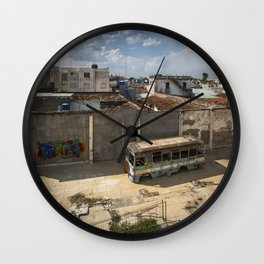 Abandoned bus in an empty backyard in Cienfuegos, Cuba. Wall Clock