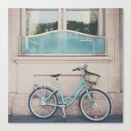 a mint green bicycle on the streets of Paris. Canvas Print