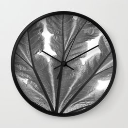 Leaf and sunlight Wall Clock