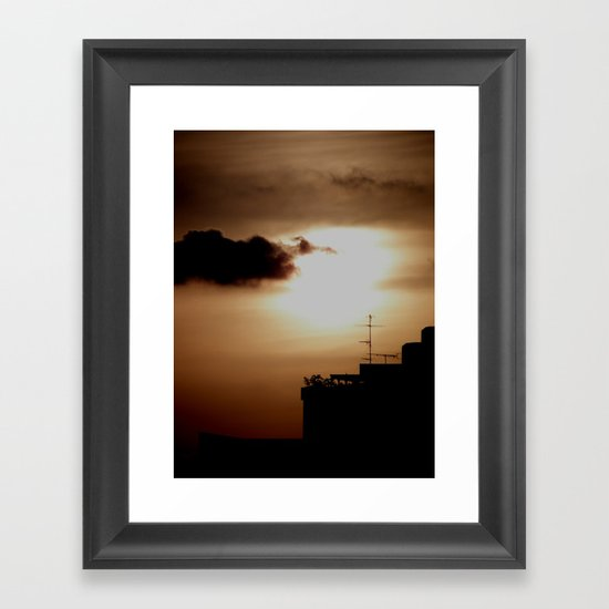 Sunset over the city Framed Art Print