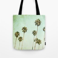 palm trees Tote Bags featuring palm trees by Mareike Böhmer