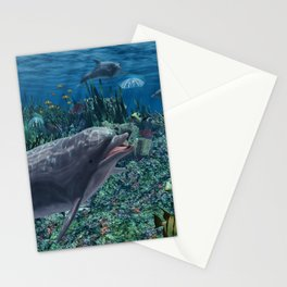 Dolphins play in the reef Stationery Cards