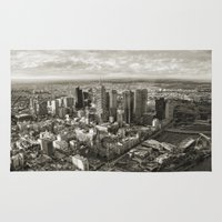melbourne Area & Throw Rugs featuring Melbourne City by Ewan Arnolda