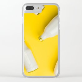Various bottles of milk on yellow background Clear iPhone Case