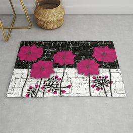 Crimson flowers on black and white background. Rug