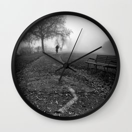 Cyclist in the fog Wall Clock