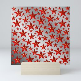 red stars and gold smilie in shiny silver Mini Art Print