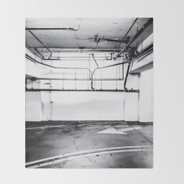 underground parking lot with tube in black and white Throw Blanket