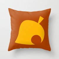 animal crossing Throw Pillows featuring Animal Crossing Autumn Leaf by Rebekhaart
