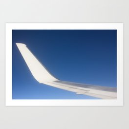 Airplane Wingtip on a blue sky Art Print