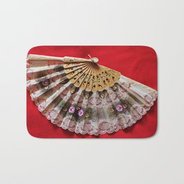 Ornate Hand Held Fan on a Red Background Bath Mat