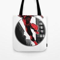 daredevil Tote Bags featuring Daredevil by Atom Manhattan