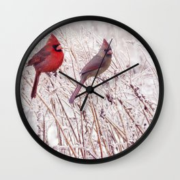 Male and Female Northern Cardinals in the winter Wall Clock