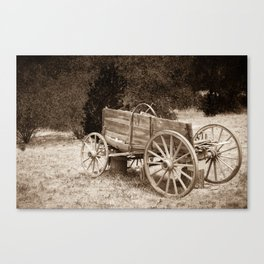 Old Wild West wagon abandoned in a meadow Canvas Print