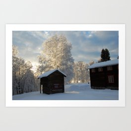 Snowy cabins and light in the trees Art Print