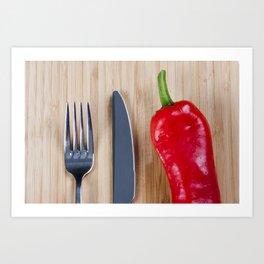 Red pepper on chopping board Art Print
