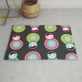 dolls matryoshka on black background, pink and blue colors Rug