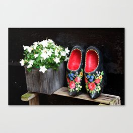 Clogs and te flowers Canvas Print