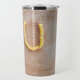 Letter done with pasta fusilli on a wooden chopping board Travel Mug