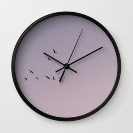 The overview | Fine art photo print of birds flying in pink purple sky Wall Clock