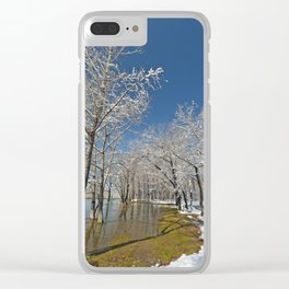 Snow-covered trees in the water near the river during the floods in the dark water Clear iPhone Case