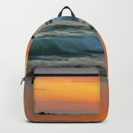 Golden sunset with turquoise waters Backpack