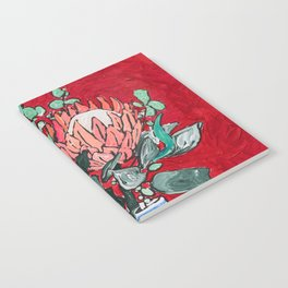 Delft Bird Vase of Proteas on Red Notebook