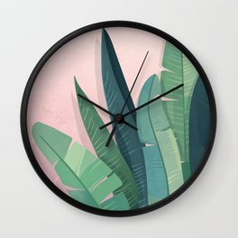 Tropical plants on pink background Wall Clock