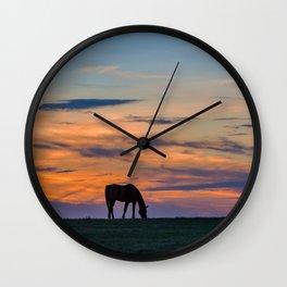 Grazing at sunset Wall Clock