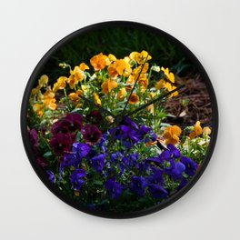 A bed of colorful pansies Wall Clock