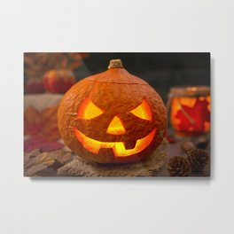 Burning Jack O'Lantern on a rustic table with autumn decorations Metal Print