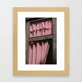 a pink curtain Framed Art Print
