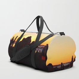 Seaside Sunset behind the wharf remains Duffle Bag