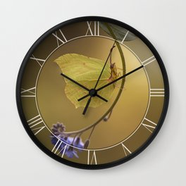 Yellow butterfly on blue forget-me-not flowers Wall Clock