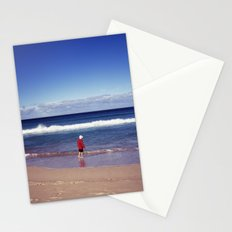 Red jacket and blue ocean Stationery Cards