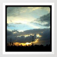 The sun peeking through the clouds. Art Print