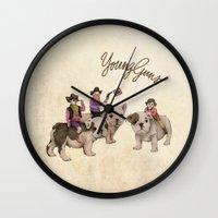 guns Wall Clocks featuring Young Guns by Katy Davis