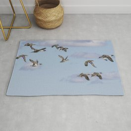 Mallards, Northern Pintails and a Green-winged Teal in Flight Rug
