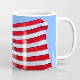 United States flag waving with a military helmet on the mast Coffee Mug