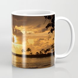 Sunset at the beach. Some palm trees against the light. Coffee Mug